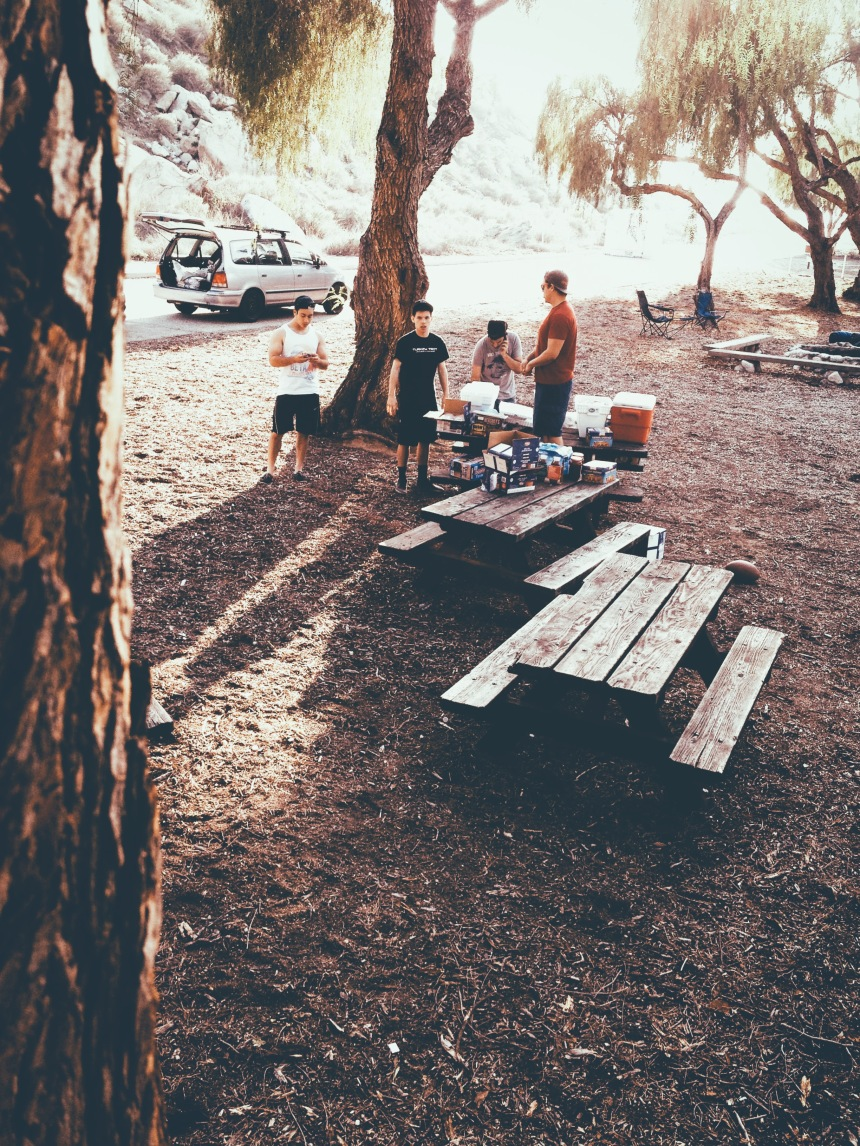Camping near Lake Perris California for a fraternity retreat old van in the background makes it looks hipster