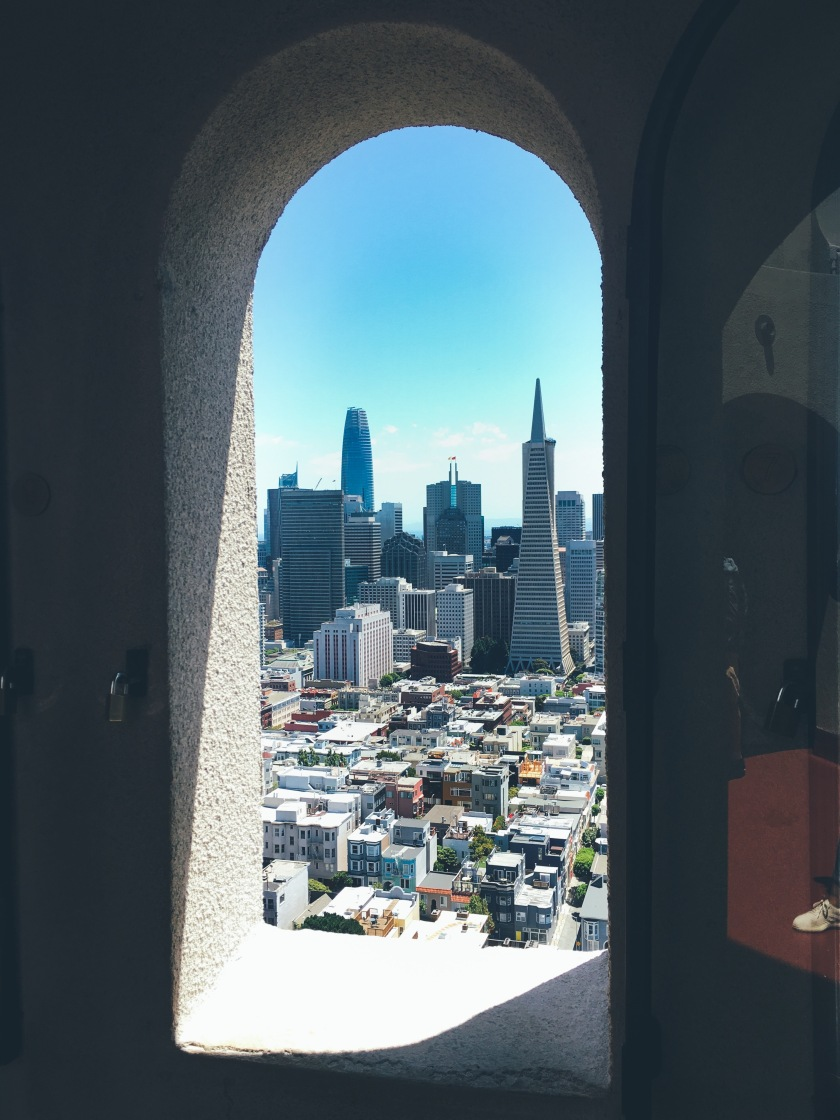 Look through coat tower of San Francisco cityscape