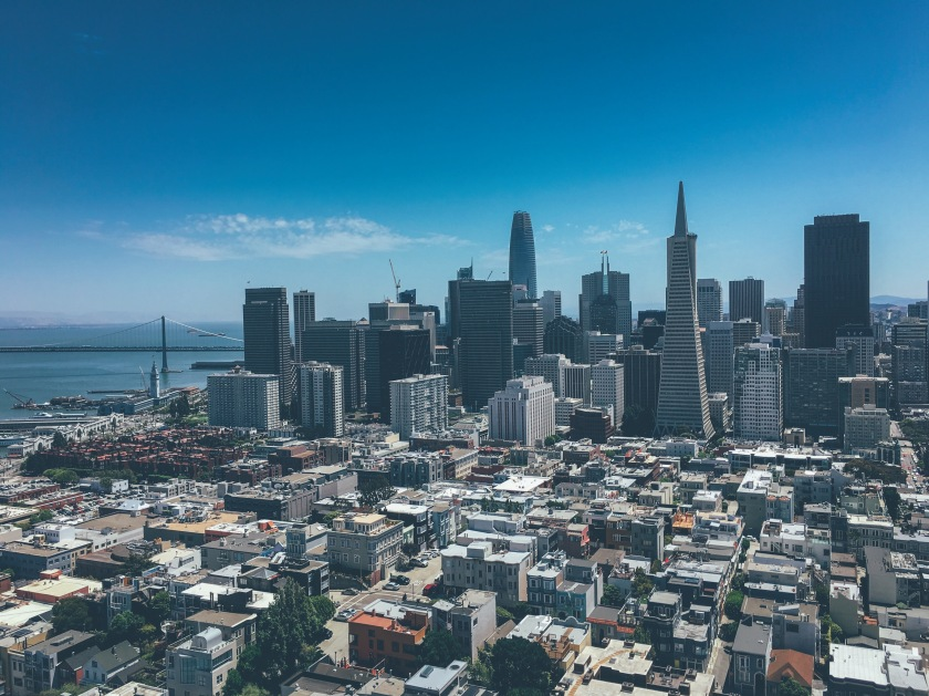 iPhone 6s Plus - San Francisco skyline with Bay Bridge in the background. Cityscape with Transamerica Building and Salesforce Building