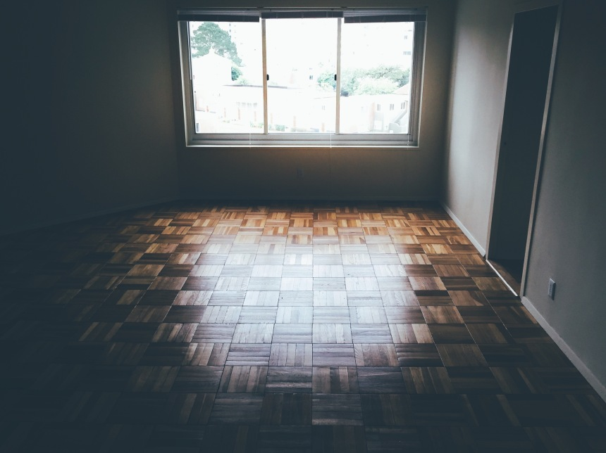 Light passing through a window and illuminating a wooden floor