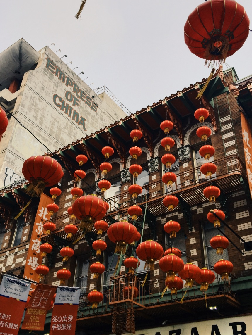 Chinatown in San Francisco California  with red lanterns hanging with empress of China in the background