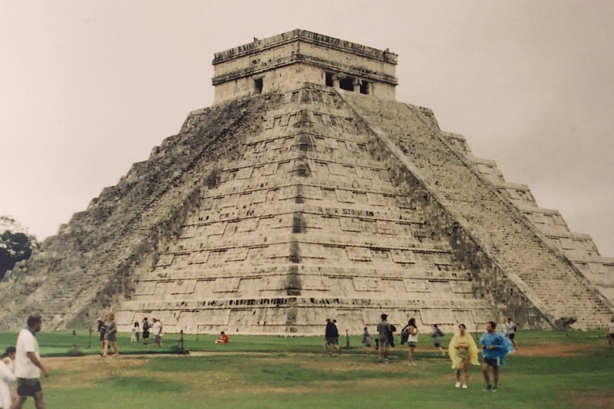35mm film photo Chichén Itzá is a complex of Mayan ruins on Mexico's Yucatán Peninsula. A massive step pyramid, known as El Castillo or Temple of Kukulcan, dominates the ancient city, which thrived from around 600 A.D. to the 1200s. Graphic stone carvings survive at structures like the ball court, Temple of the Warriors and the Wall of the Skulls. Nightly sound-and-light shows illuminate the buildings' sophisticated geometry.