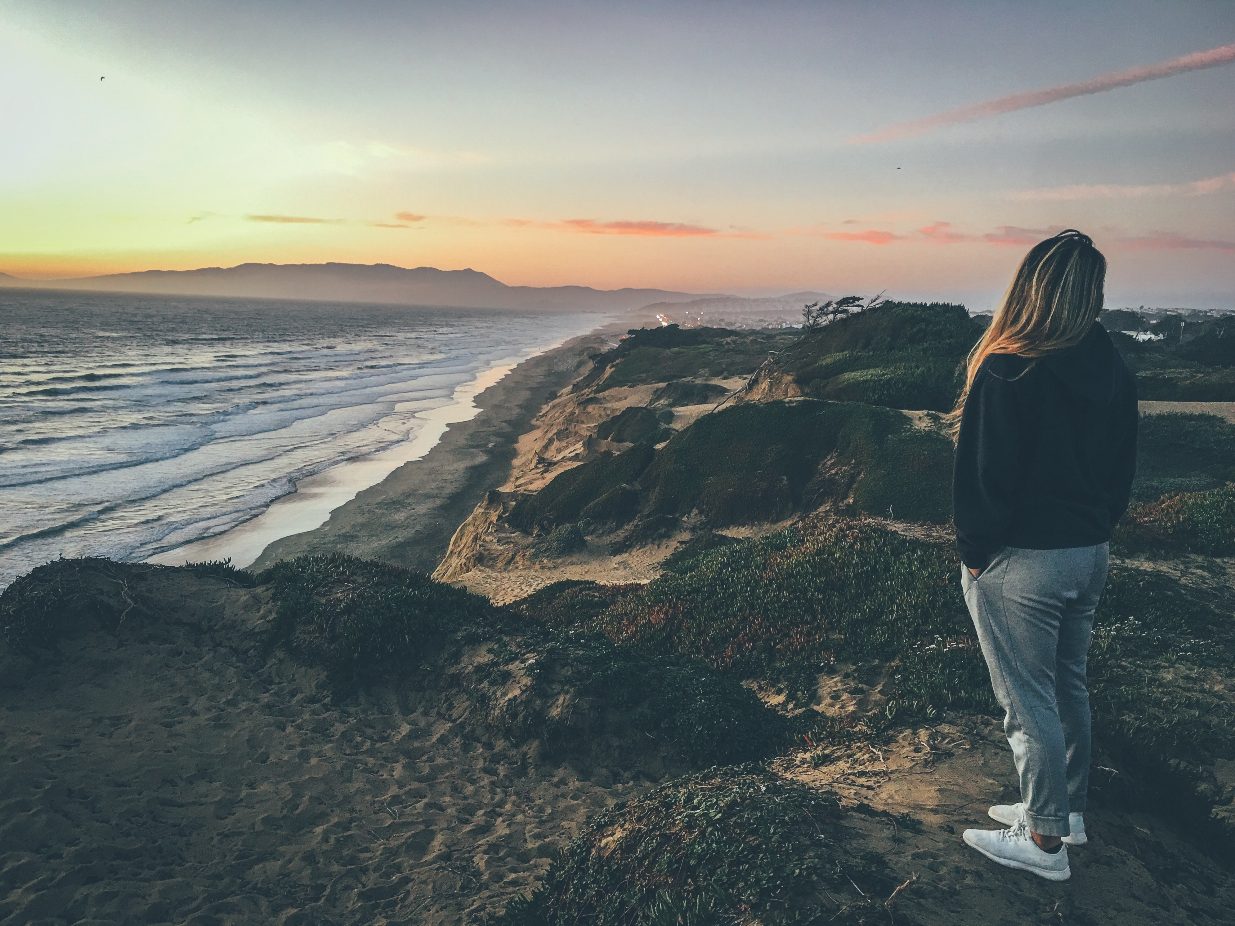 fort function San Francisco california, sunset beach waves gold skies and girl in foreground